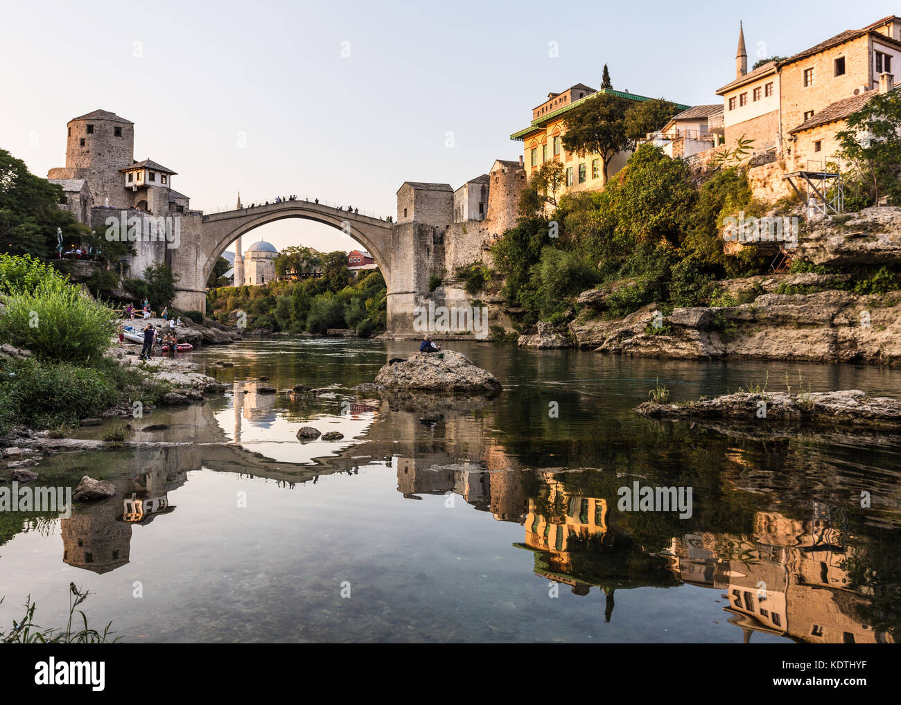 Sunset over the famous bridge in Mostar in Bosnia and Herzegovina in the Balkans in South Eastern Europe - Stock Image