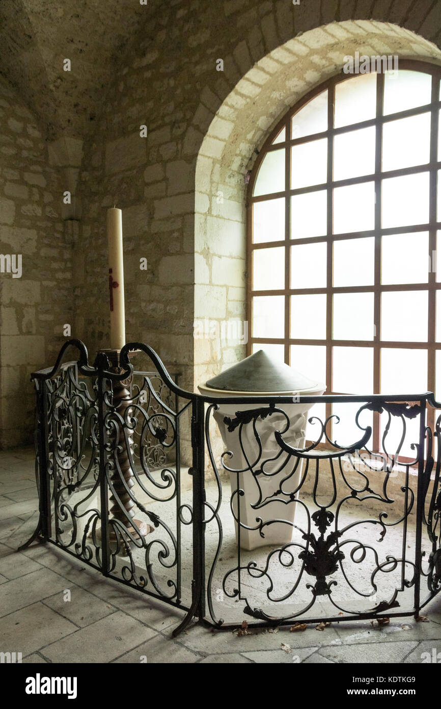 Souillac, France. Font and Easter Candle. Church of Saint Marie. - Stock Image