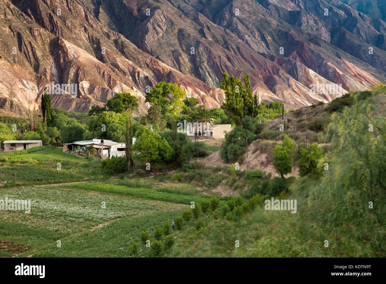"Farmland near Maimará, with the ""Painter's Palette"" hills beyond, Quebrada de Humahuaca, Jujuy Province, Argentina Stock Photo"