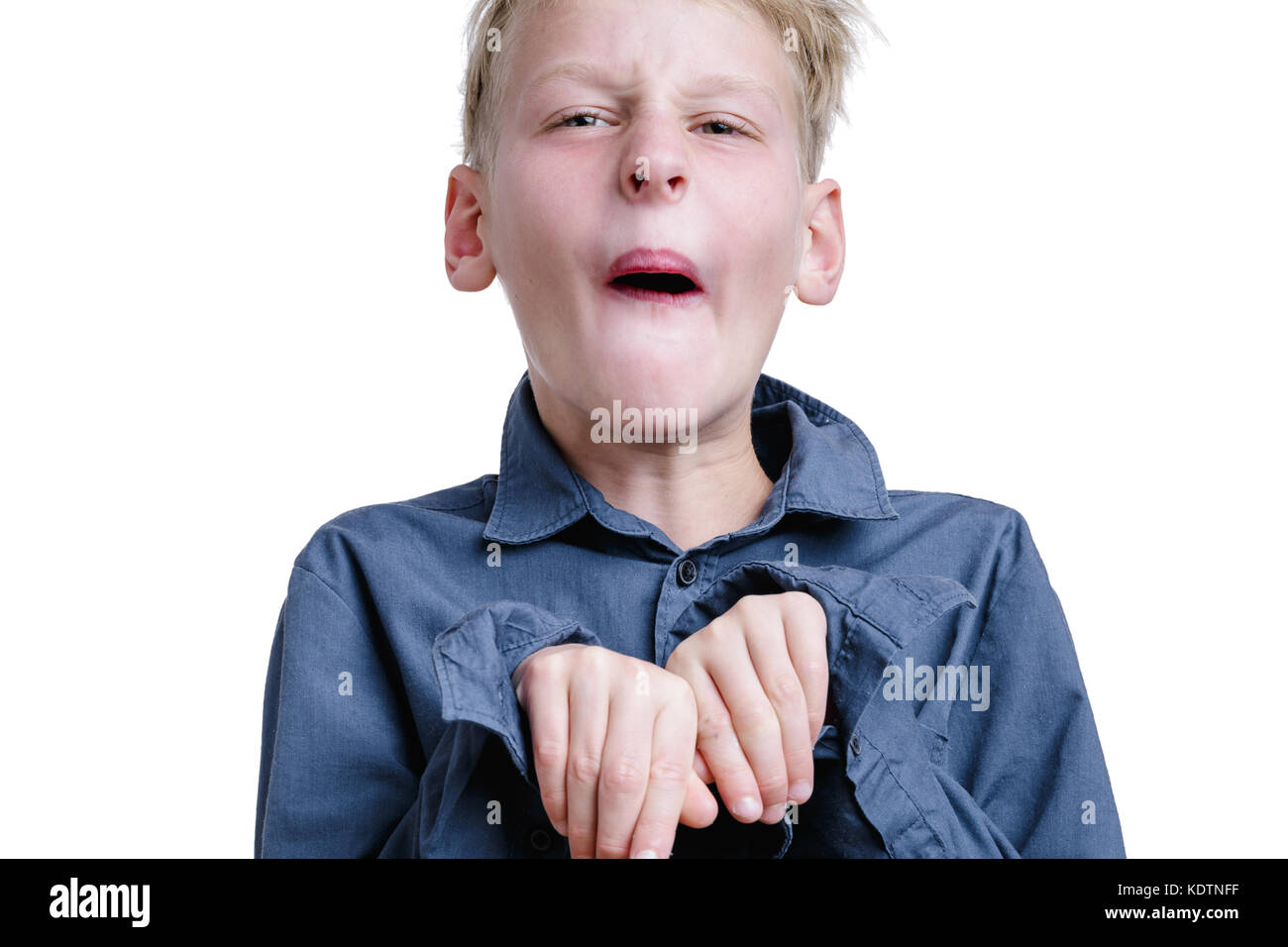 10-years old boy making a face - Stock Image