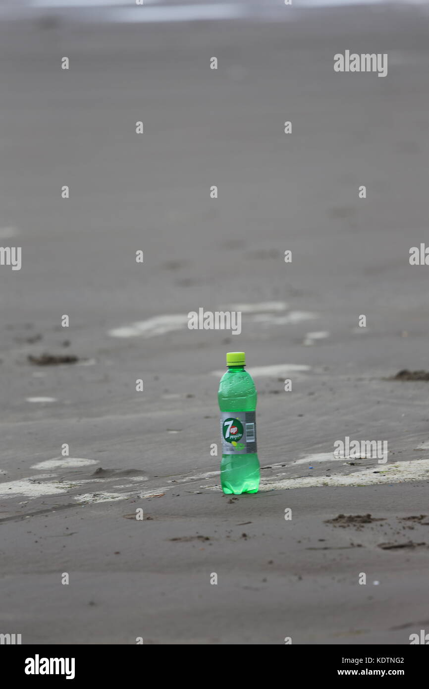 7 up bottle on a beach in Ireland - Stock Image