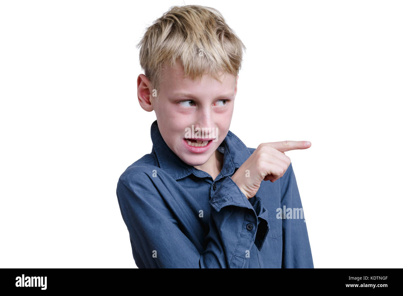 10-years old boy pointing on somebody. - Stock Image