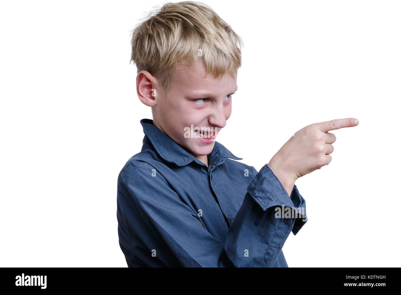 10-years old boy pointing on somebody. Isolated on white - Stock Image