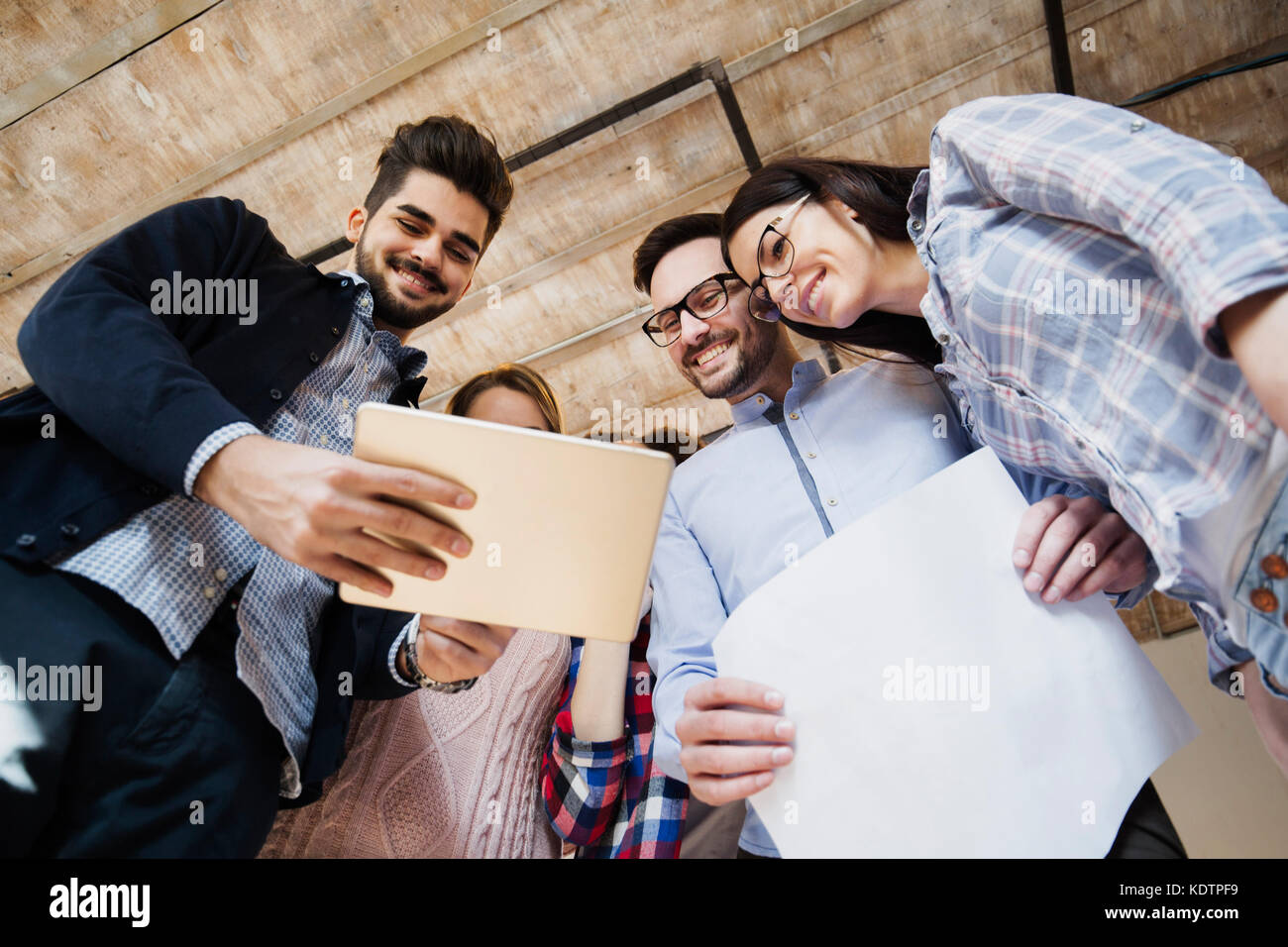 Young perspective designers looking at project schemes Stock Photo