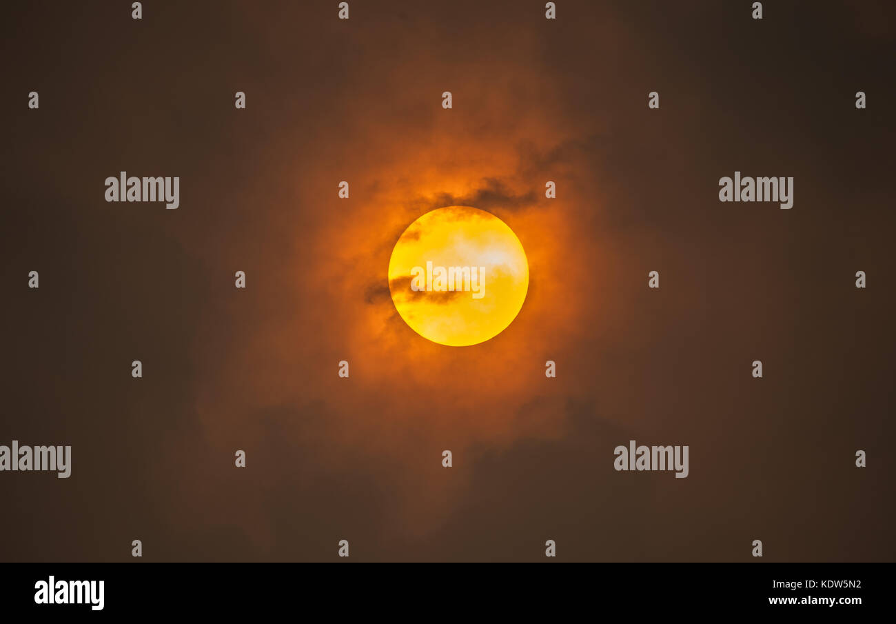 Sahara Sun - the sun on October 16th 2017 when the4 sky went orange across the southern UK due to the sahara sand - Stock Image