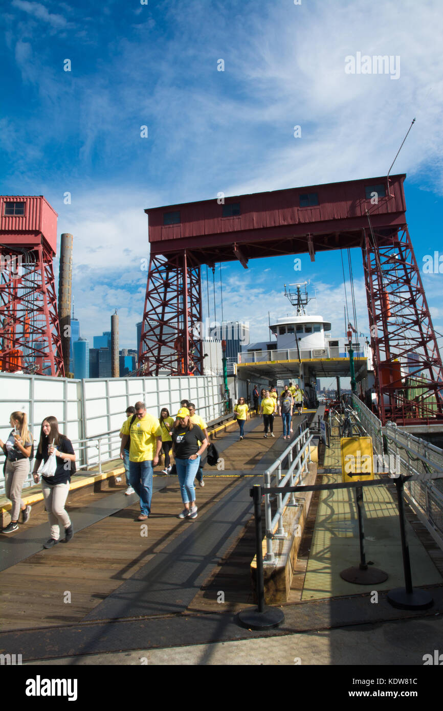 Tourists and visitors arrive at Governors Island from the Governors Island Ferry, Manhattan, New York, NY, USA - Stock Image