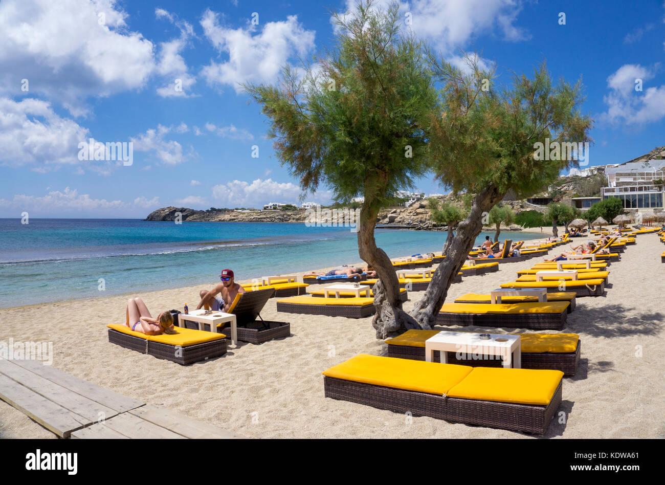 Tourists at Paradise beach, popular beach at Mykonos - Stock Image
