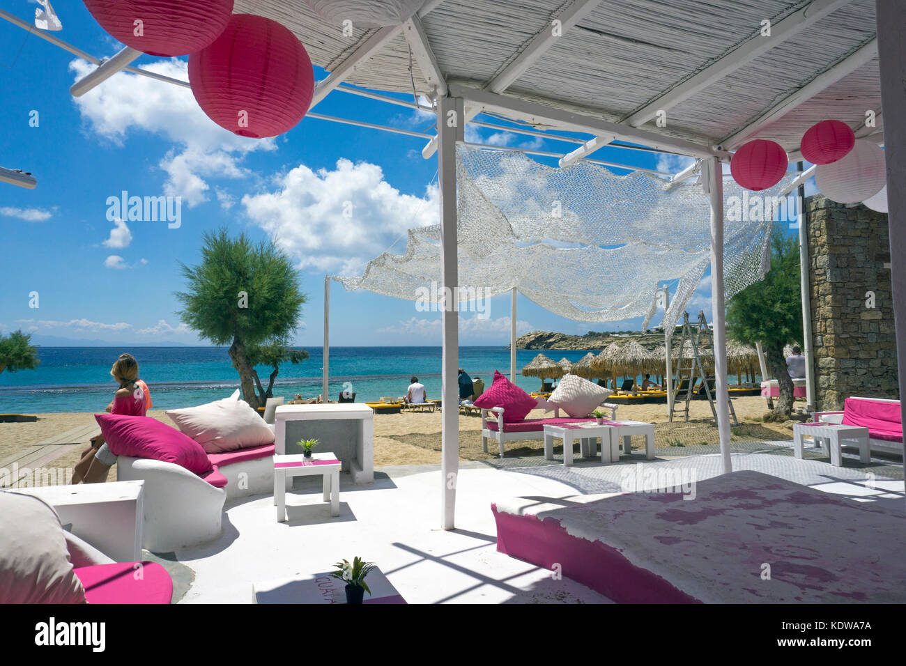 Tourists at beach bar, Paradise beach, Mykonos - Stock Image