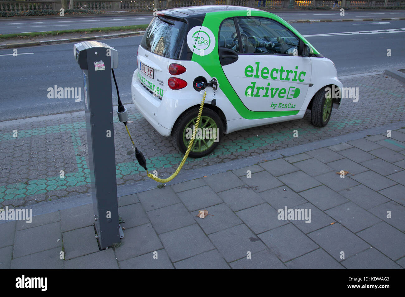 recharging an electric car in brussels belgium - Stock Image