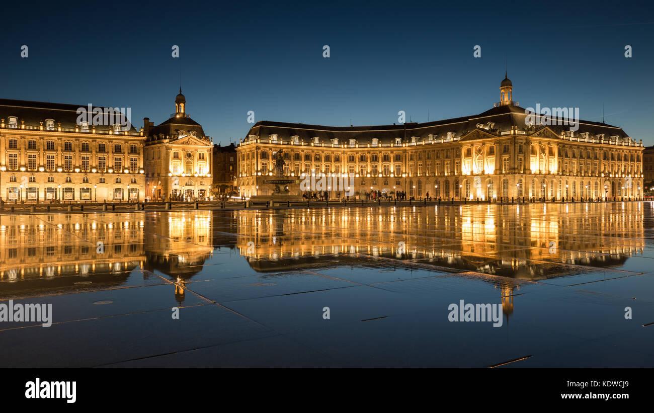 Miroir d'eau at dusk, Place de la Bourse, Bordeaux, Acquitaine, France - Stock Image