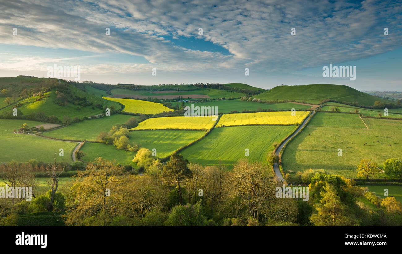 The road to Corton Denham via Kember's Hill & Whitcombe from Cadbury Castle, South Somerset, England - Stock Image