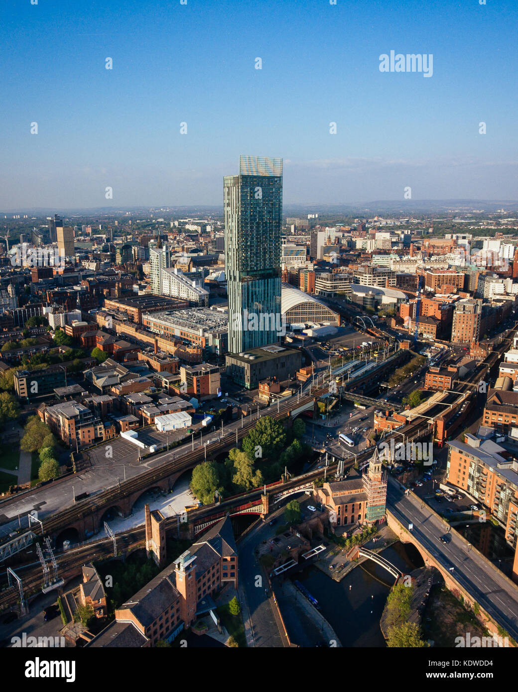 A drone view of the Manchester skyline on a summer day. - Stock Image
