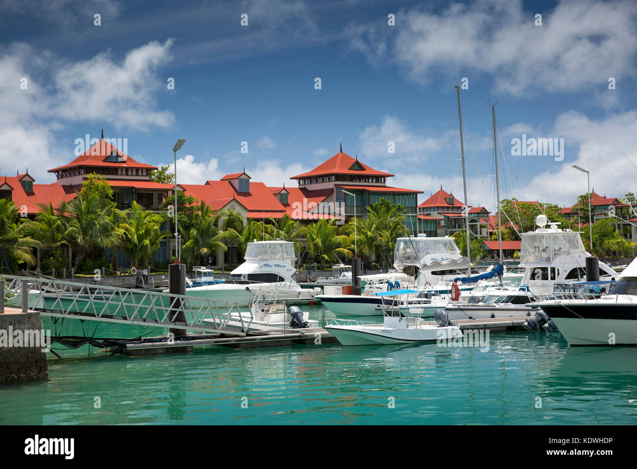 The Seychelles, Mahe, Victoria, Eden Island, housing on reclaimed land and boats moored in marina - Stock Image