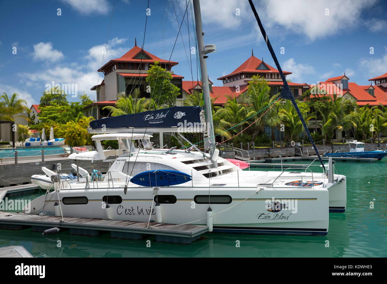 The Seychelles, Mahe, Victoria, Eden Island, housing on reclaimed land and boats moored in marina, rental catamaran - Stock Image