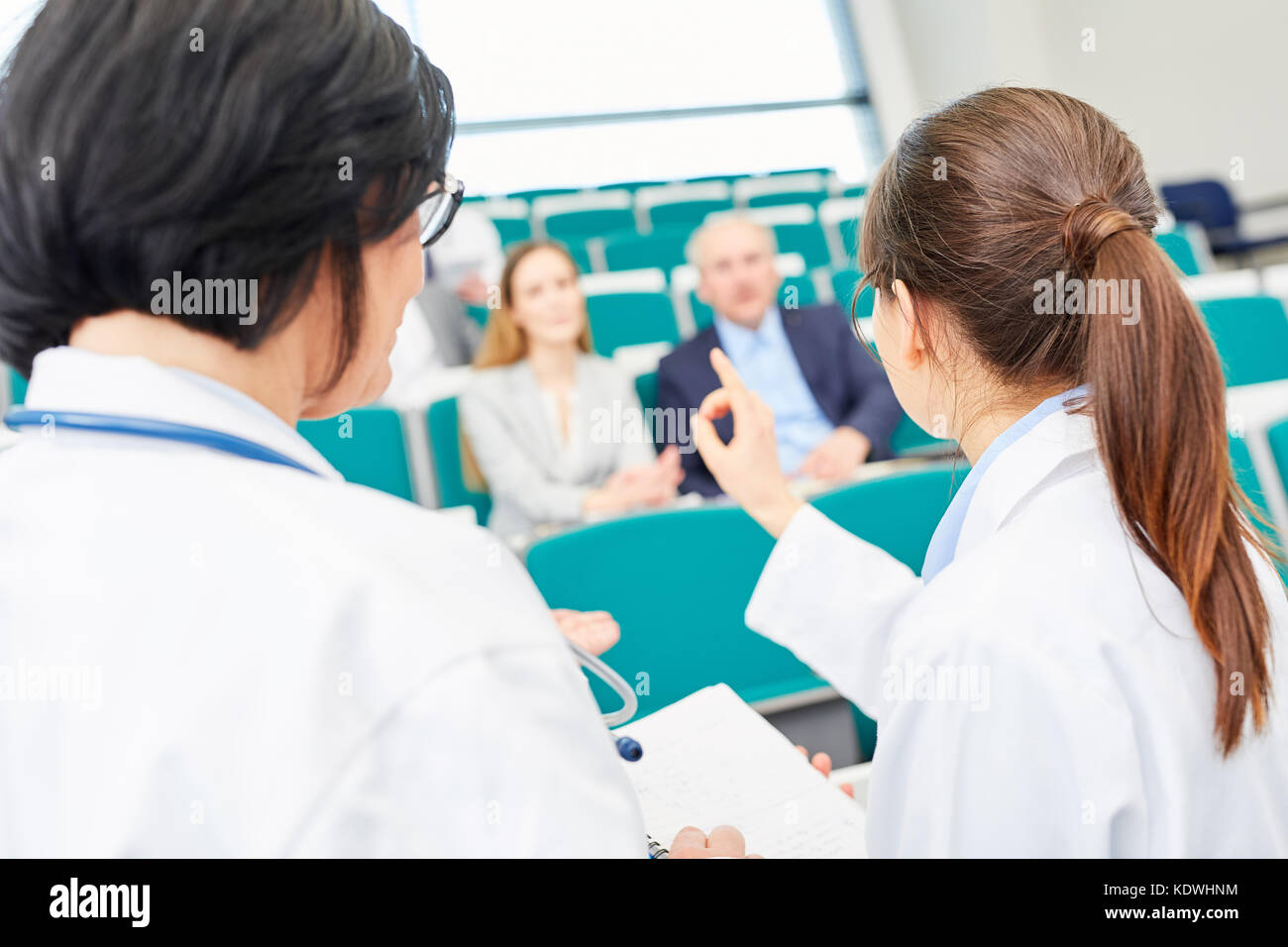 Young woman as student taking test in medical school - Stock Image