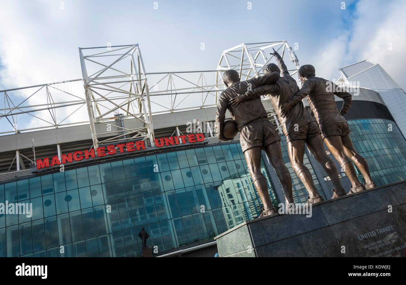 The United Trinity sculpture by Philip Jackson outside Old Trafford. Home of Manchester United Football Club. - Stock Image