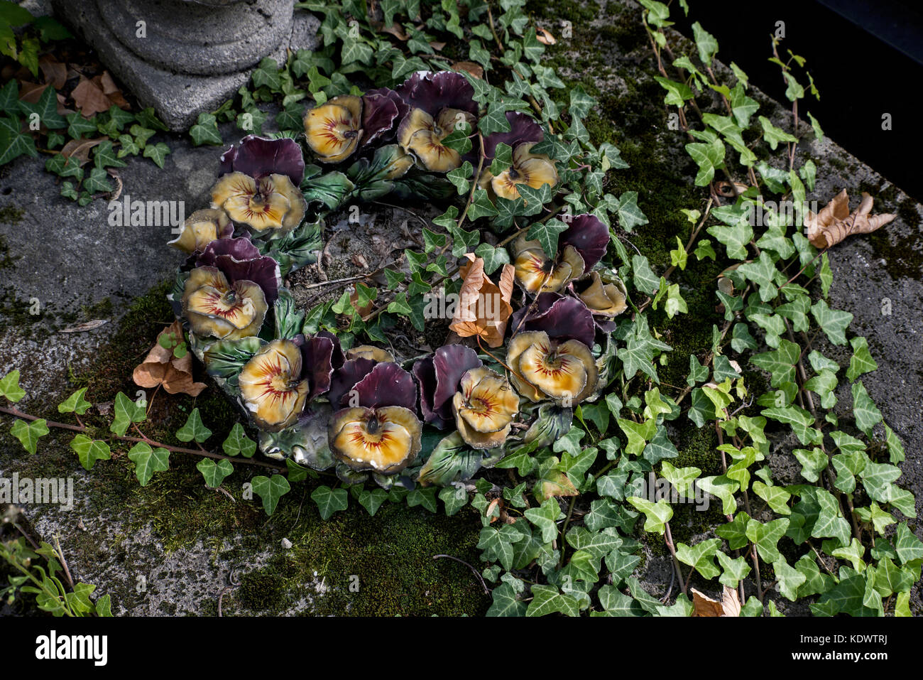 Ceramic flowers on a grave in pere Lachaise Cemetery, Paris, France - Stock Image
