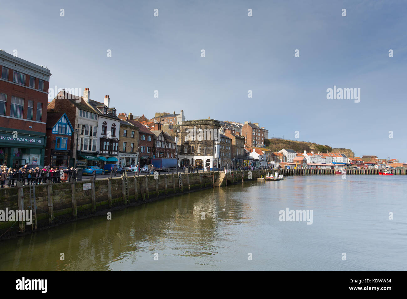 Whitby harbour North Yorkshire England uk seaside town and tourist destination fine February weather - Stock Image