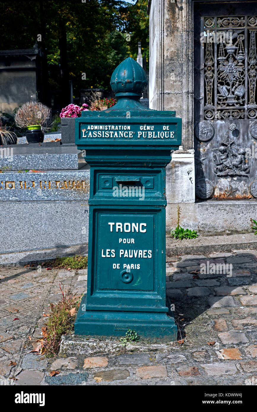 Poor Box at the entrance to Pere Lachaise cemetery, Paris, France. - Stock Image