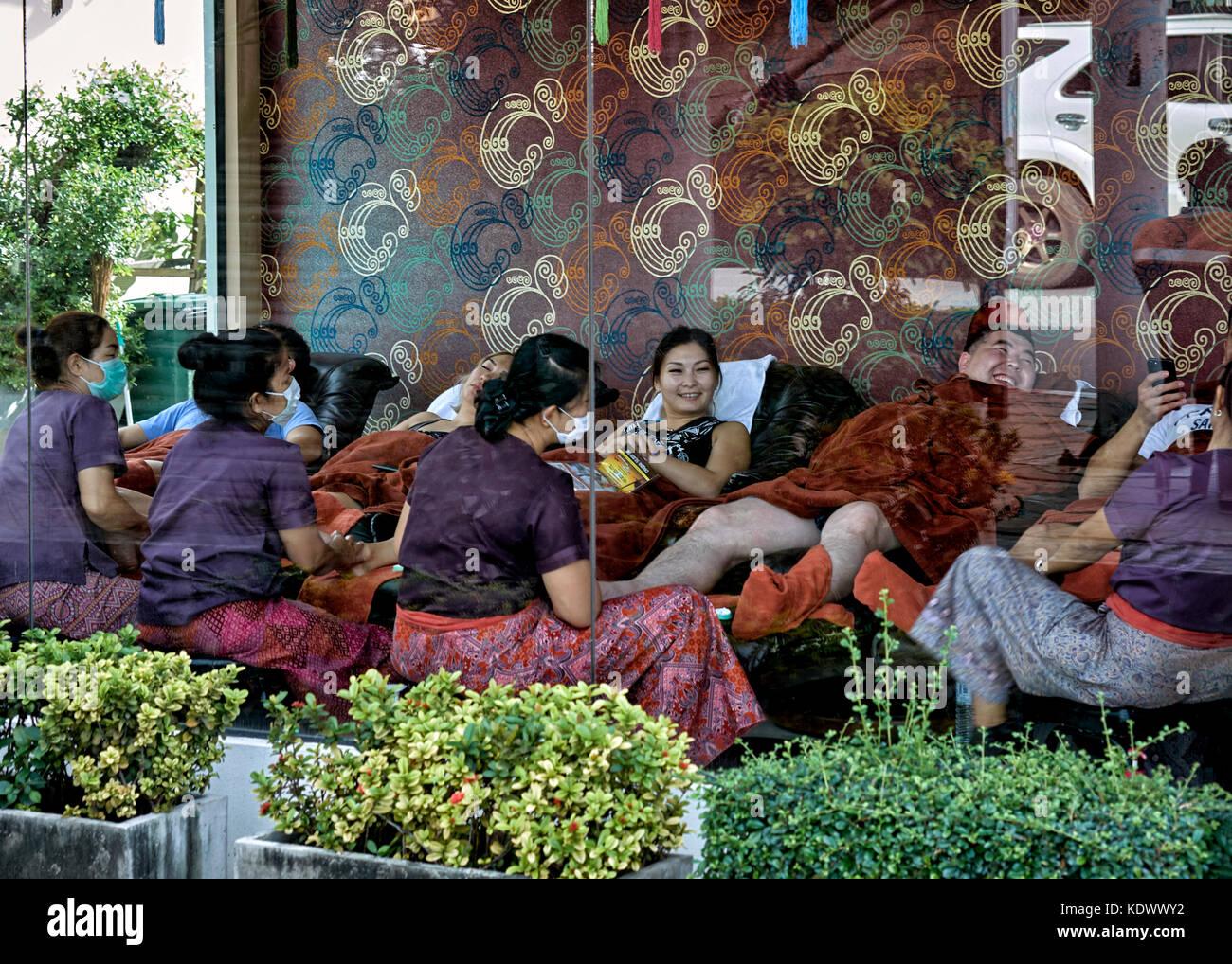 Thailand massage parlour. Foot massage parlor, masseuse. - Stock Image