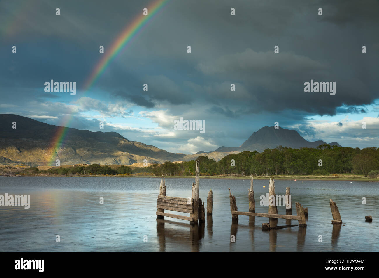 A rainbow over Loch Maree & Slioch, Wester Ross, Scotland, UK - Stock Image