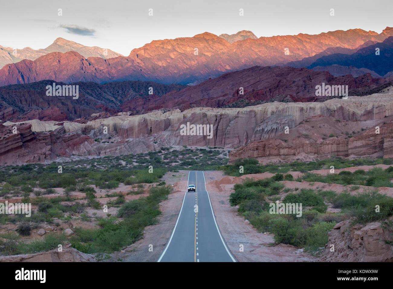 A car on the road at Quebrada de la Conches, Valles Calchaquies, Salta Province, Argentina - Stock Image