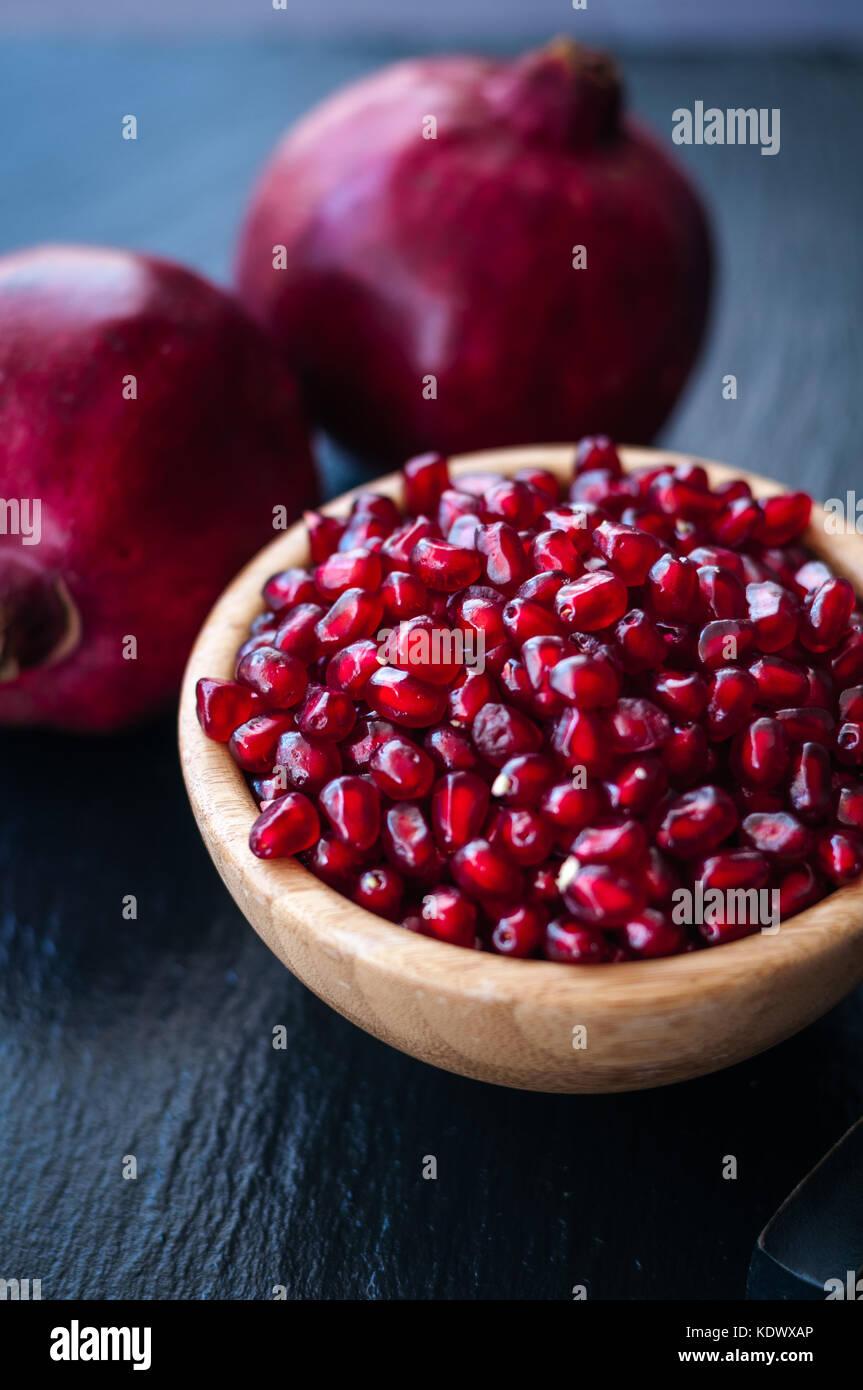 fresh pomegranate on a black background - Stock Image