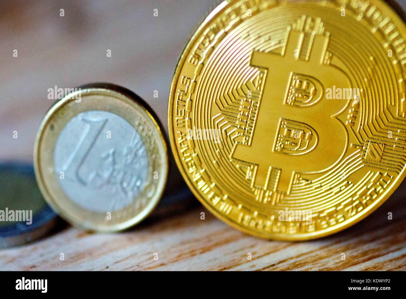 Bitcoin Replica and One Euro coin - Stock Image
