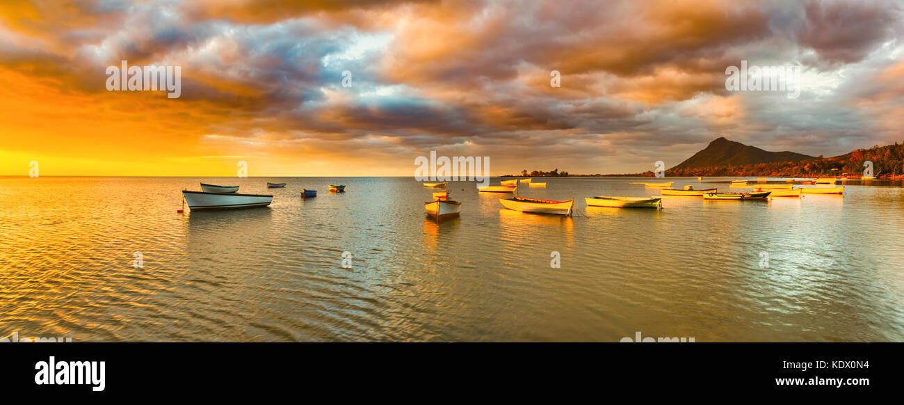 Fishing boats at sunset time. Amazing landscape.. Mauritius. Panorama - Stock Image
