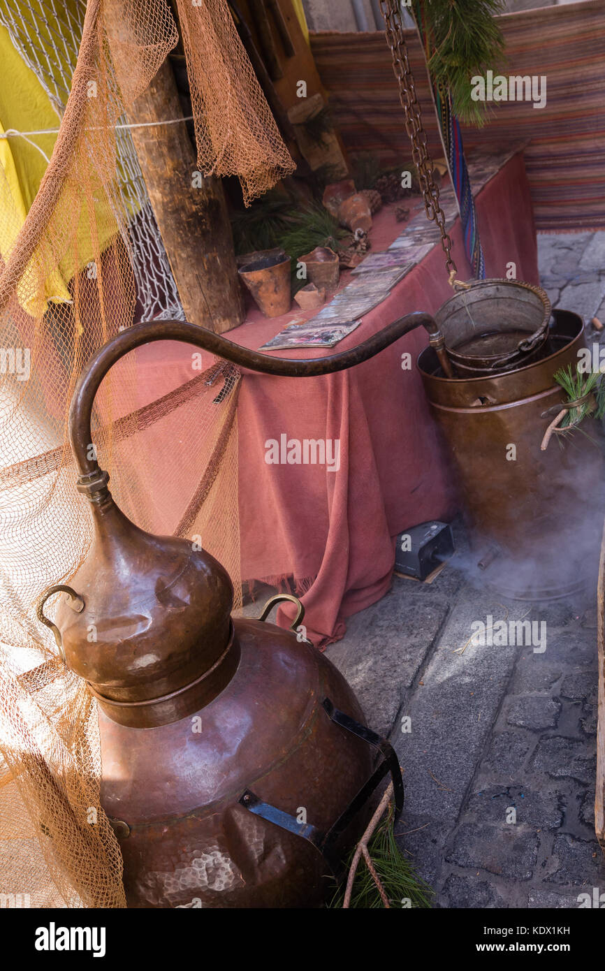 recreation of an old brass alembic for the production of alcoholic beverages - Stock Image