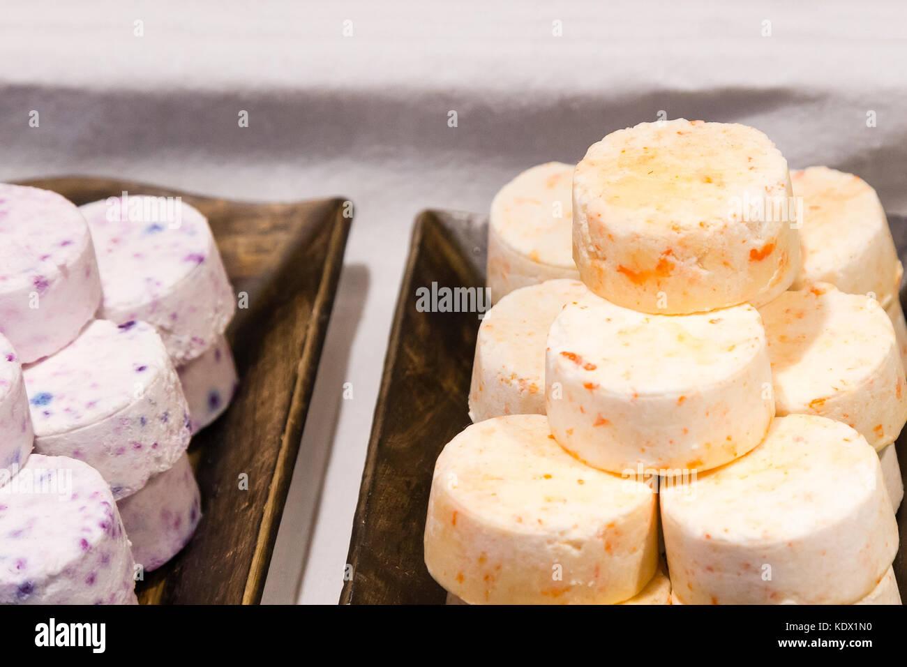 assortment of pills soap handmade on wooden trays - Stock Image