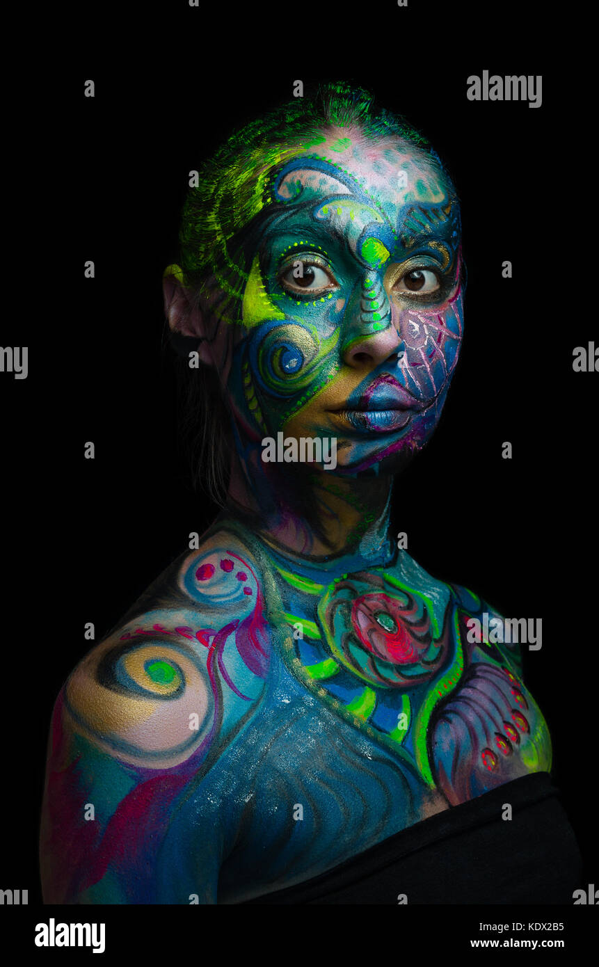 Beautiful body art - Artistic face (front view) eyes open - Stock Image