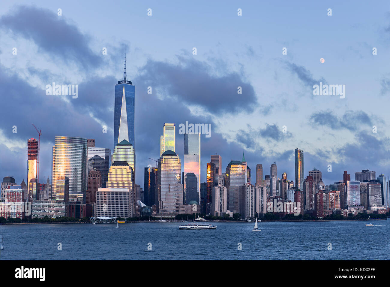 Lower Manhattan Skyline and moon rising at blue hour, NYC, USA - Stock Image