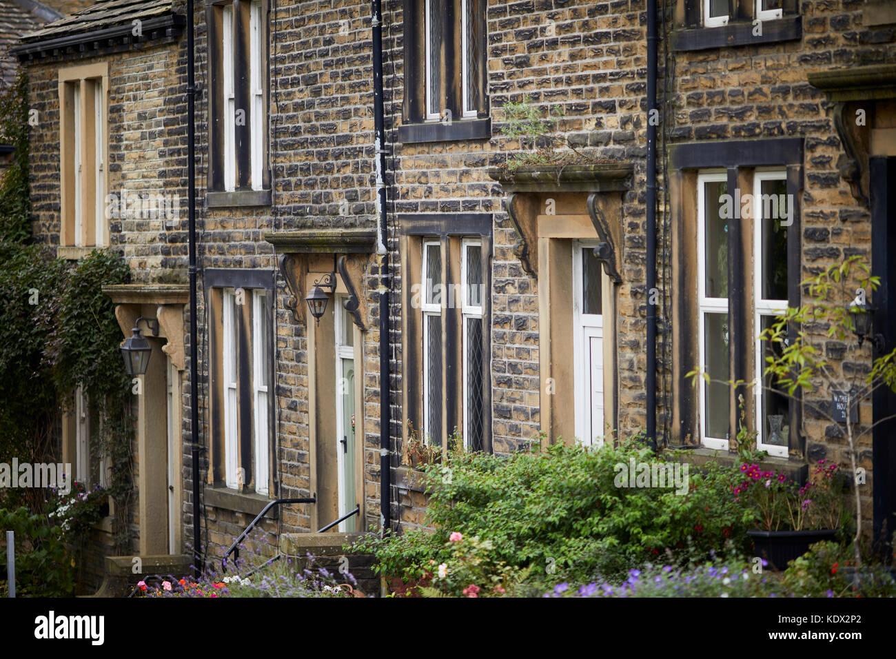 Pennines village, Haworth in West Yorkshire, England. stone terraced cottages on Bridgehouse Lane Stock Photo