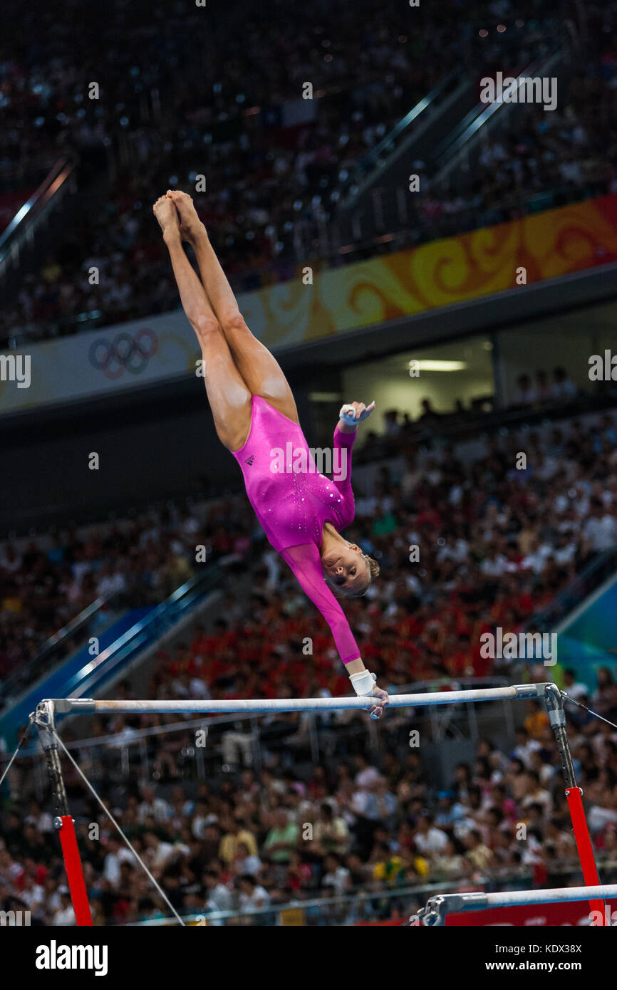Nastia Liukin (USA) Women's Individual All Around Gymnastics gold medalist competing on the uneven bars at the 2008 Stock Photo