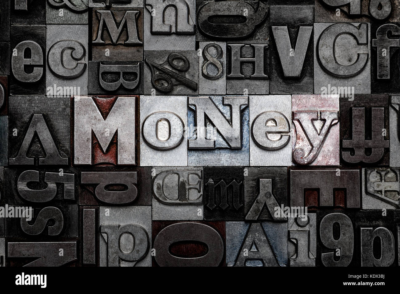 The word Money made from old metal letterpress letters - Stock Image