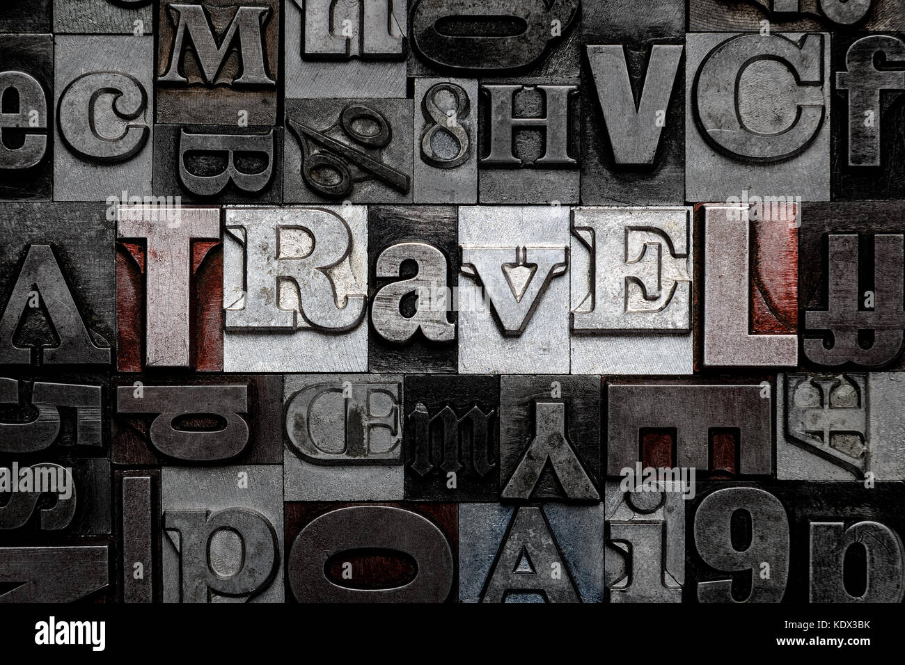 The word Travel made from old metal letterpress letters - Stock Image