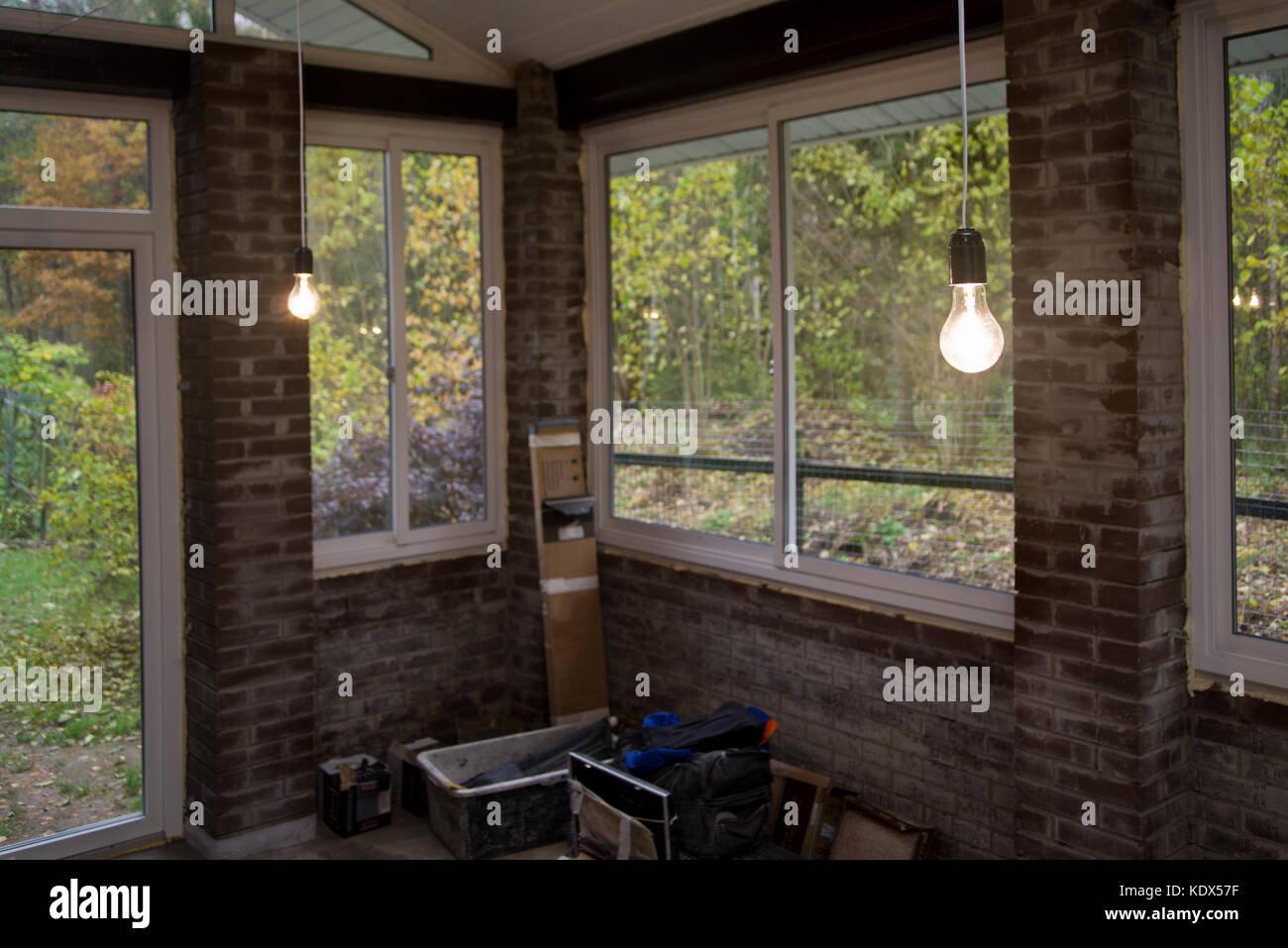 Renovation of veranda with brick wall and work tools on the ... on