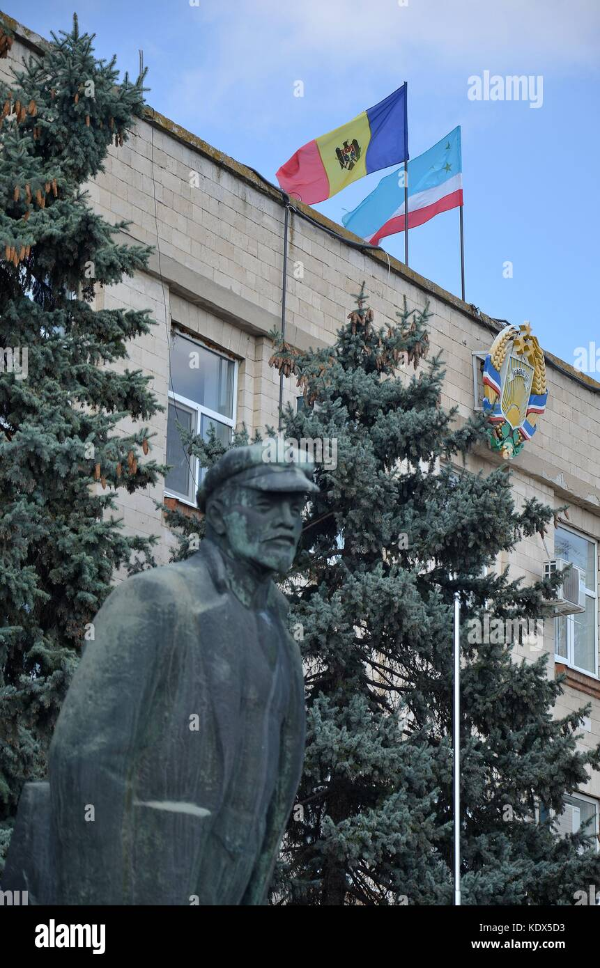 Parliament in Comrat, the capital of Gagauzia, Republic of Moldova, and the statue to Lenin Stock Photo