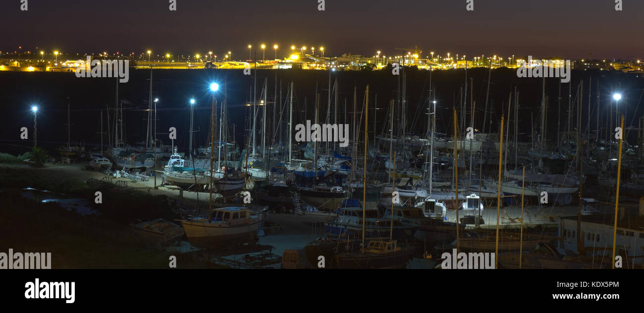 Boats harbour at night n Faro. Algarve, Portugal - Stock Image