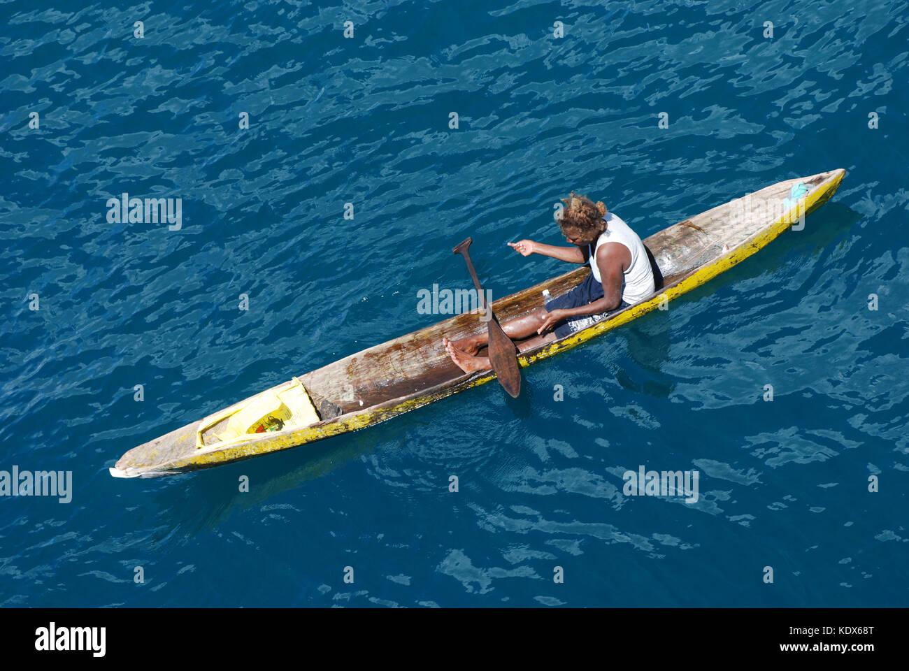 Local Fisherman in Dugout Canoe off Honiara Solomon Islands - Stock Image