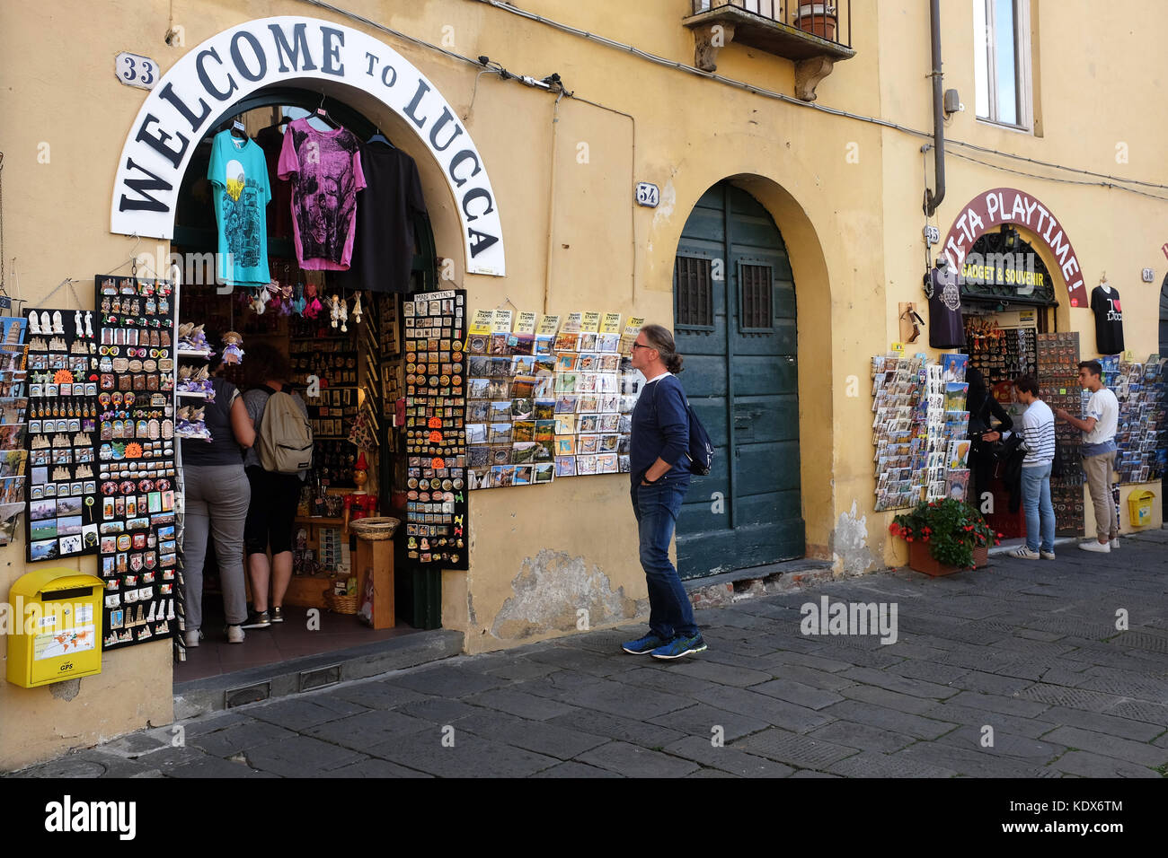 The beautiful Italian City of Lucca with its narrow streets and tourist shops in the Tuscany Region of Italy. - Stock Image