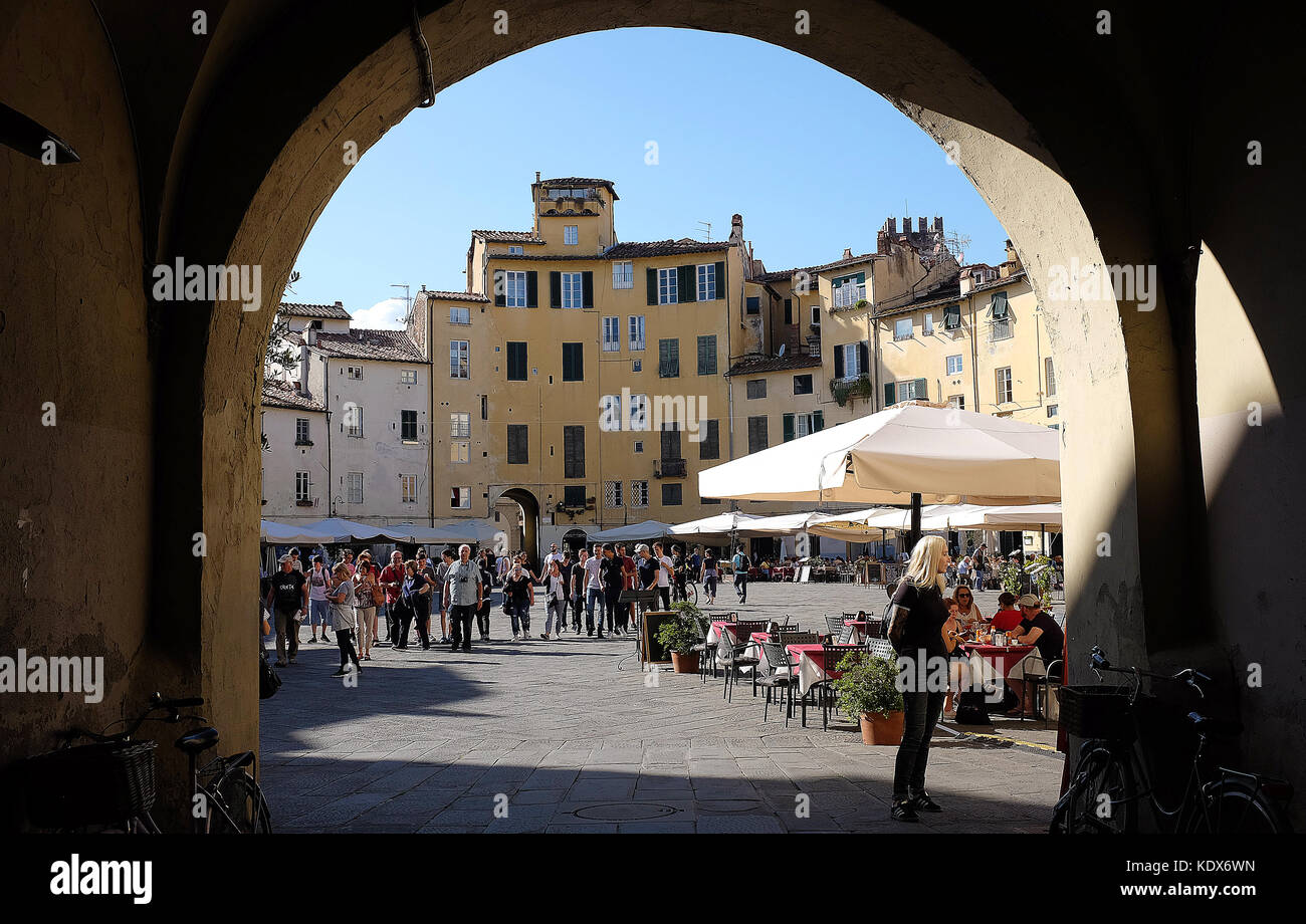 The beautiful Amphitheatre in the walled City of Lucca in the Tuscany region of Italy. - Stock Image
