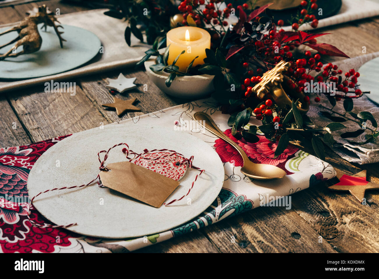 Christmas place setting, name card and rustic Christmas table with ...