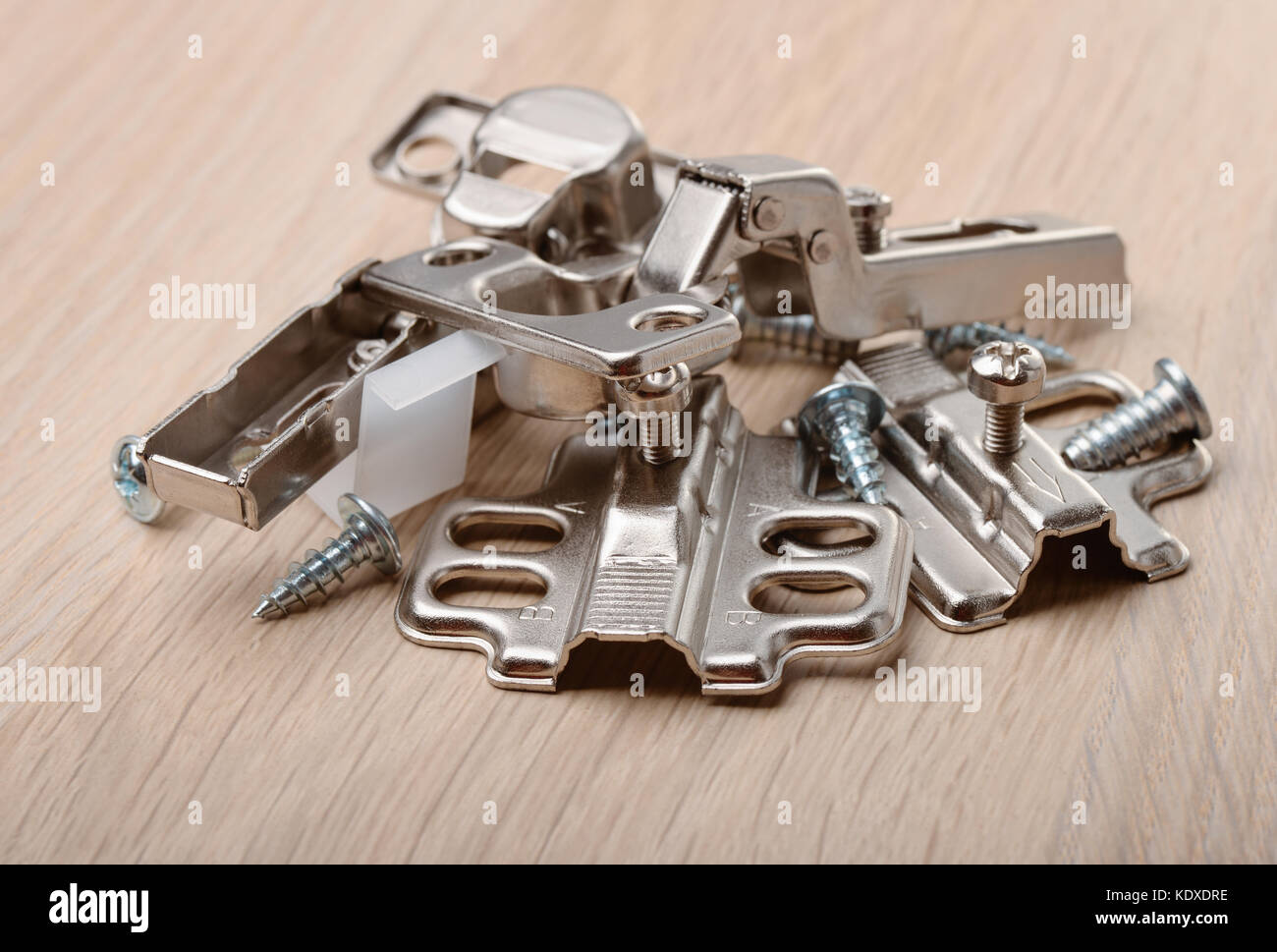 Close up of furniture fittings on furniture board - Stock Image