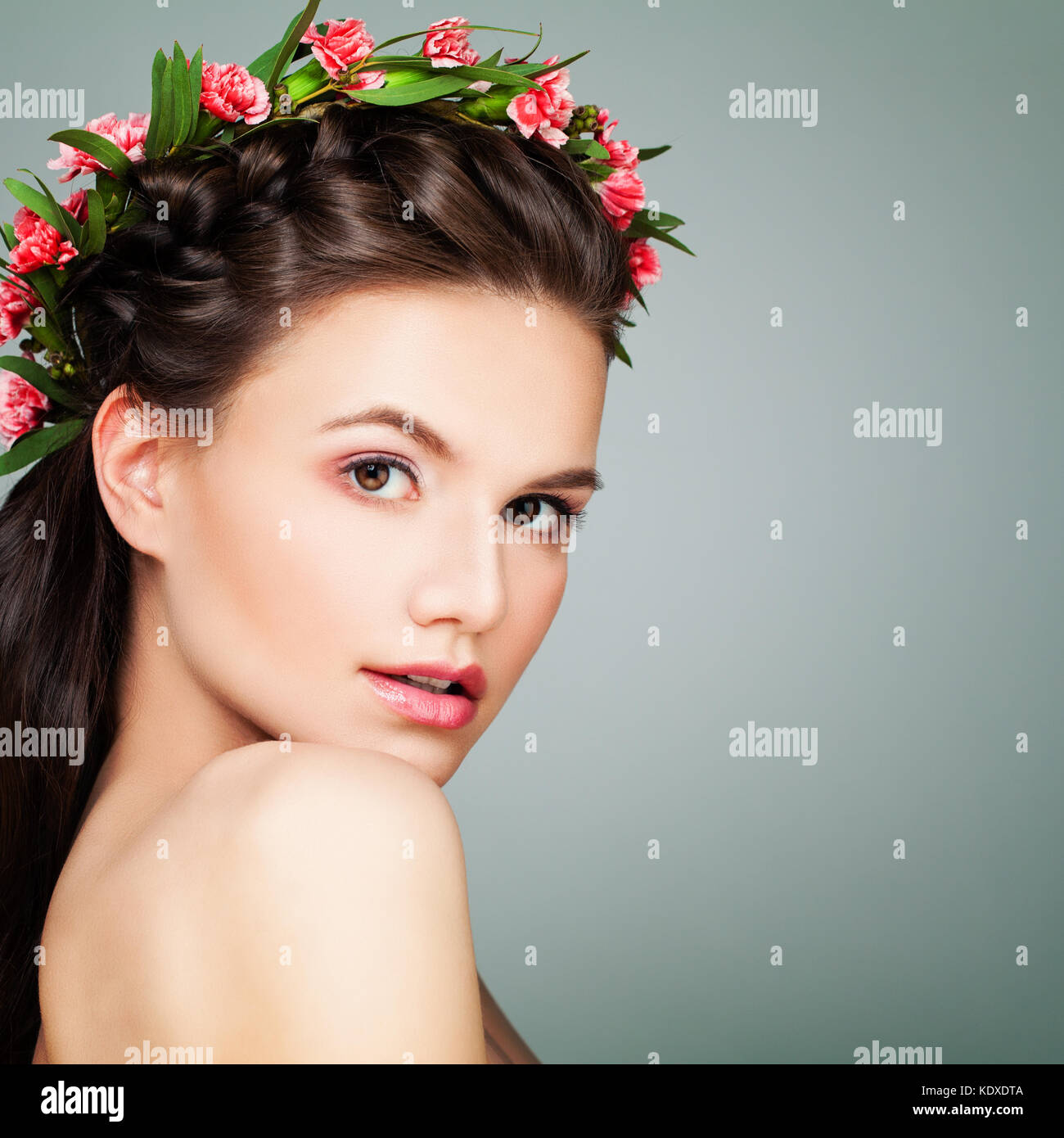Spa Beauty. Perfect Woman with Healthy Skin and Flowers. Aesthetic Medicine and Cosmetology Concept - Stock Image