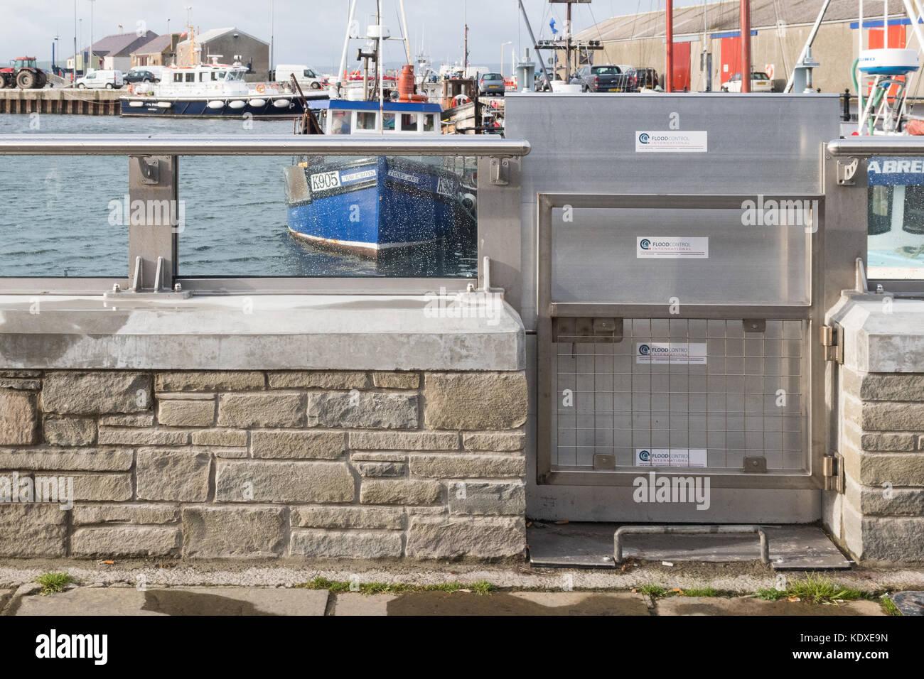 glass floodwall and flood gate - Kirkwall Harbour Flood Defence Scheme, Kirkwall, Orkney, Scotland, UK - Stock Image