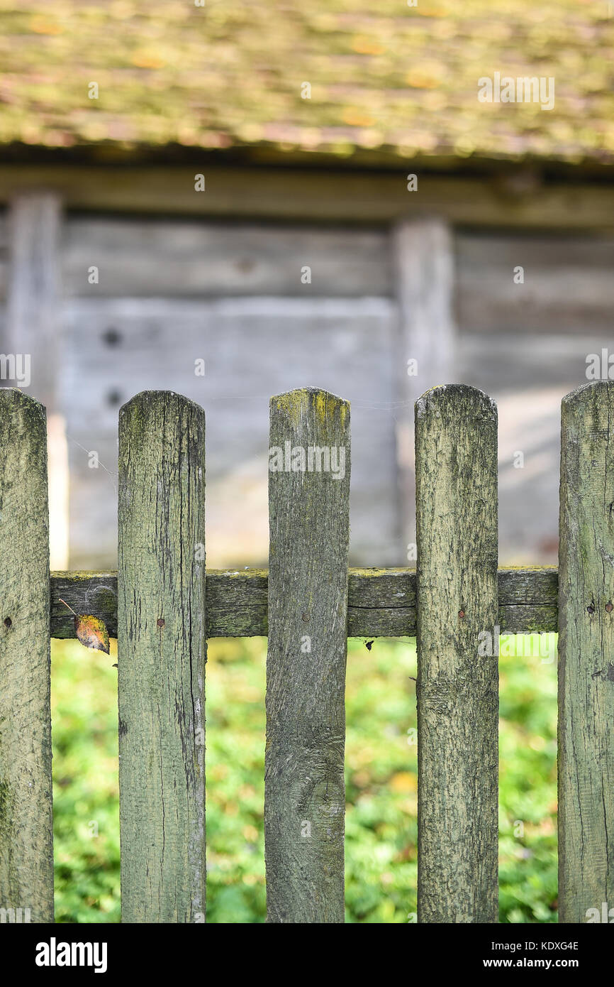 Old wooden fence, wooden wall of barn on background, copy space, life in the village, Western Ukraine Stock Photo