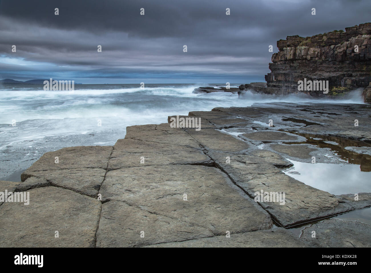 Atlantic Waves crash onto the rocks at Downpatrick Head, Co.Mayo - Stock Image