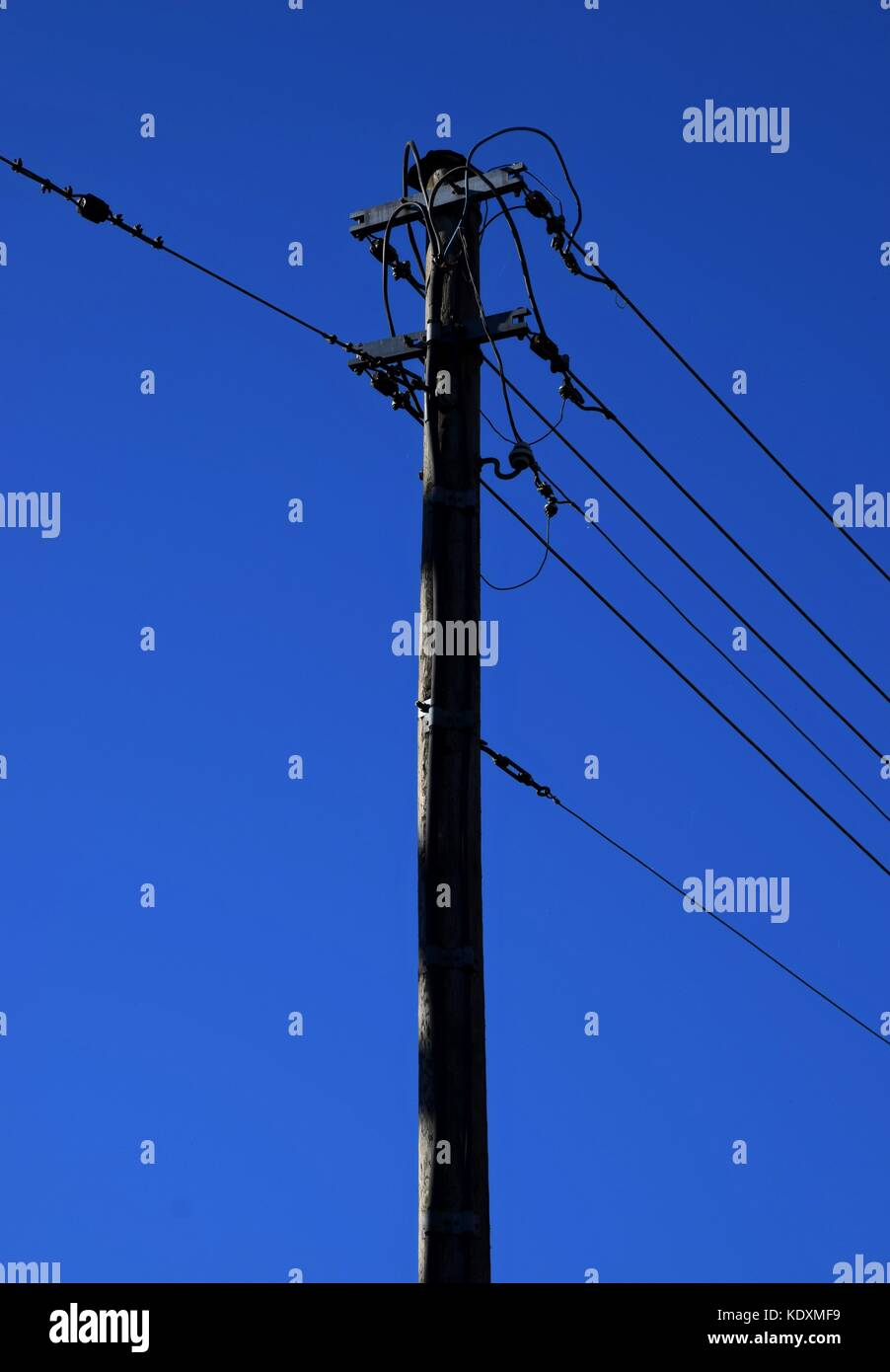 high power pole in the Country, power cable in autumn with colorful blue sky - Stock Image